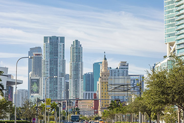 Miami city skyline taken from street perspective, showing Freedom Tower and MDC Wolfson campus in the center