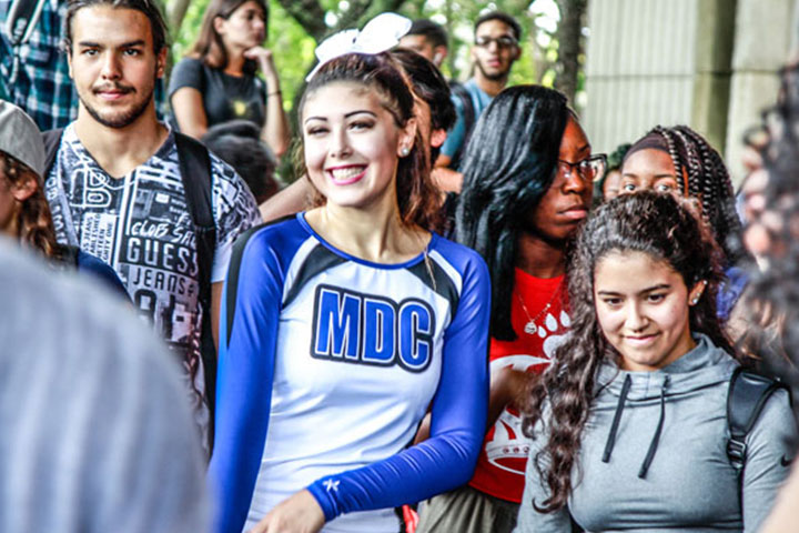 Group of students stand together at MDC event