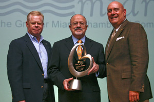 Miami Dade College President Dr. Eduardo J. Padrón (center) recently received the Henry M. Flagler Award, named after Miami's founding father, for the Greater Miami Chamber of Commerce, for his vision and leadership in higher education. Here, he is joined by Chamber President Barry Johnson (left) and new Chamber Chairman Carlos Fernández-Guzmán, an MDC alumnus.