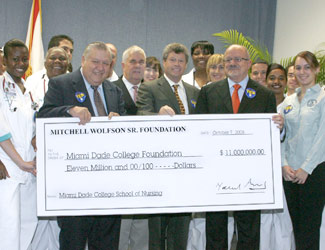 Donors, College administrators and students with an $11 million check